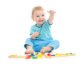 Happy cheerful kid playing educational toys isolated on white