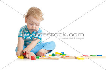 Concentrated child playing logical education toys with great int