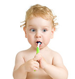 child brushing teeth isolated on white
