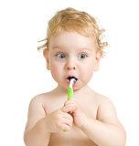 child brushing teeth isolated on white