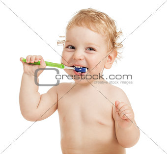 Happy child brushing teeth