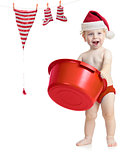 Happy kid in Santa&#39;s hat washing his accessories