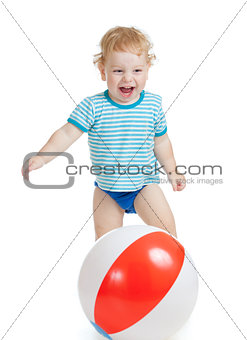 Happy child playing with colorful ball isolated on white