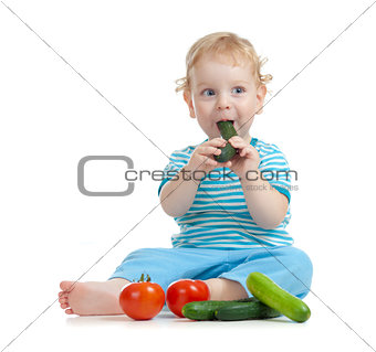 happy child eating healthy food vegetables isolated