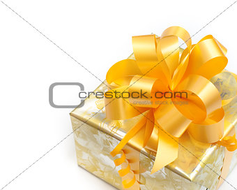 Nice gift packed in golden paper with yellow bow on white backgr