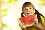 girl with a piece of watermelon