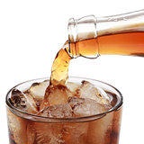 Cola pouring into a glass, isolated