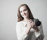Woman holding antique camera