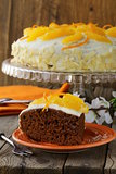 fruit cake with white cream and orange