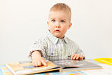 curious baby boy studying with the book