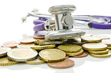 Stethoscope over Euro coins