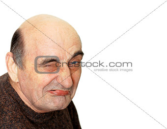 old man with a grimace on his face