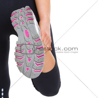 Closeup on sole of stretching fitness woman