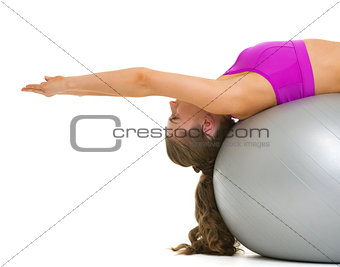 Fitness young woman making exercise on fitness ball