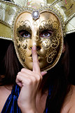 Young woman in a Venetian mask