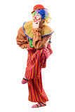 Funny clown standing on one leg