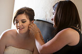 Woman Helping Bride with Earrings