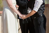 Women Holding Hands in Wedding Ceremony