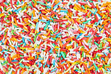 Colorful candy sprinkles background