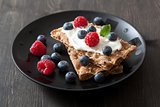 crisp bread with creme fraiche and berries