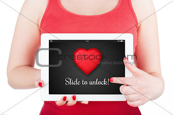"A girl is holding a tablet computer with inscription ""Slide to unlock""."