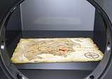 a treasure map into a safe
