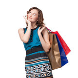 Portrait of young woman carrying shopping bags