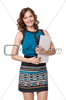 Portrait of a happy young woman posing with a laptop