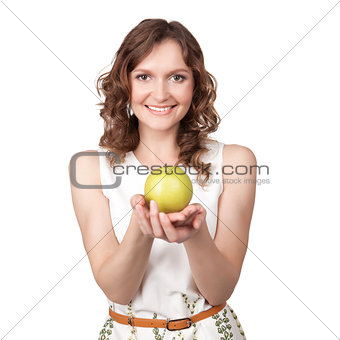 Portrait of young girl which gives of a green apple
