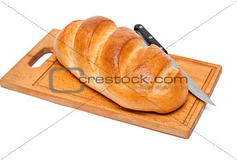 bread with knife on breadboard