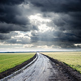dirty road to cloudy horizon