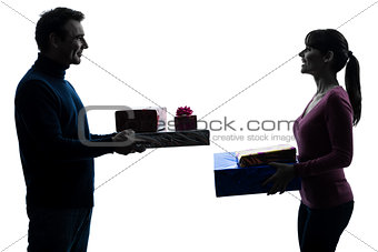 couple woman man offering christmas gifts  silhouette