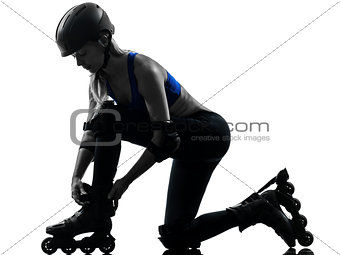 woman tying roller skates  silhouette