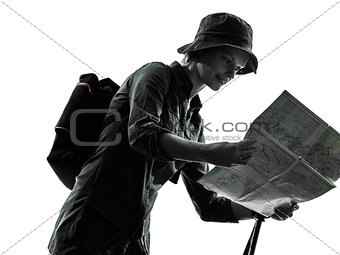 woman trekker trekking looking at map silhouette
