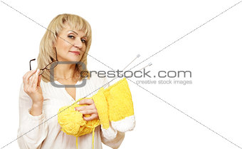 woman with glasses and a yarn