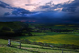 Stormy sky over bright countryside landscape