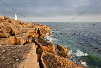 Stunning geological rock cliff formations with waves crashing in