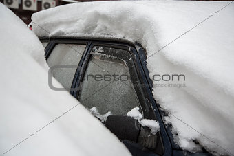 car under the icy crust