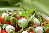 salad with arugula, tomatoes and mozzarella cheese