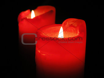 beautiful candles shining in the darkness