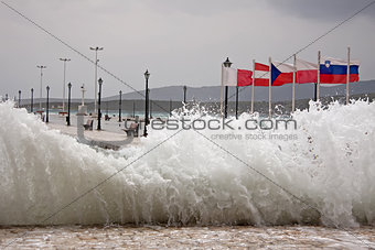 Wave Crashing On The Pier