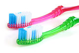 Two colorful tooth-brushes