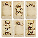 Grunge cards with human skulls and bones