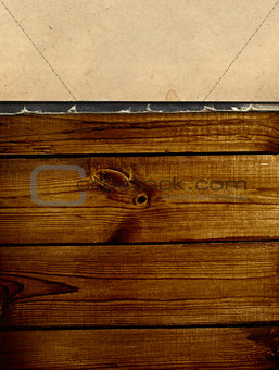 Old book on wooden planks