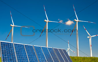 modern white wind turbine with solar paneling