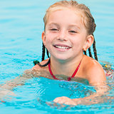 pretty little girl in swimming...