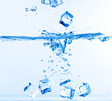 Ice Cubes Dropped into Water with Splash