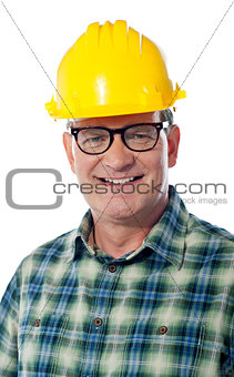 Closeup of senior architect in hardhat, smiling
