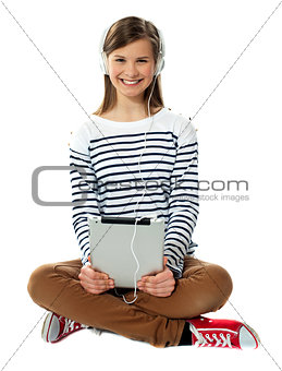 Teenager enjoying music through headphones