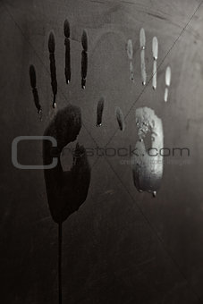 wet hand prints on wall